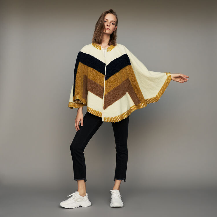 Poncho with sheepskin : Knitwear color White