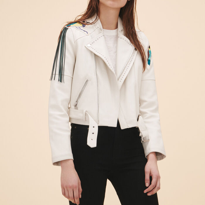 Leather jacket with badges and studs - LEATHER - MAJE