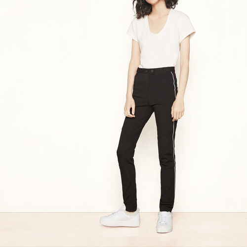Leggings with contrasting piping : Trousers & Jeans color Black 210
