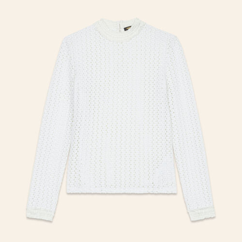 Top with a mixture of embroidery : Tops color White